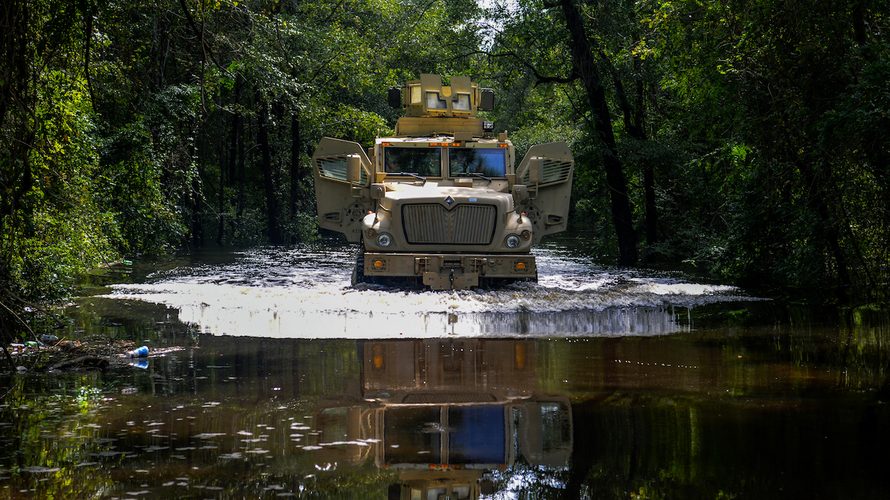 <div class='meta'><div class='origin-logo' data-origin='Creative Content'></div><span class='caption-text' data-credit='U.S. Army National Guard via Getty Images'>A U.S. Air Force Security Forces Airmen assists law enforcement with evacuation efforts as the Black Creek river begins to crest in Florence, S.C.</span></div>