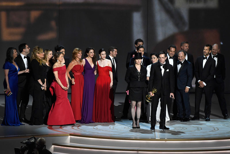 "<div class=""meta image-caption""><div class=""origin-logo origin-image ap""><span>AP</span></div><span class=""caption-text"">Daniel Palladino and the cast and crew of ""The Marvelous Mrs. Maisel"" accept the award for outstanding comedy series at the 70th Primetime Emmy Awards. (Photo by Chris Pizzello/Invision/AP)</span></div>"
