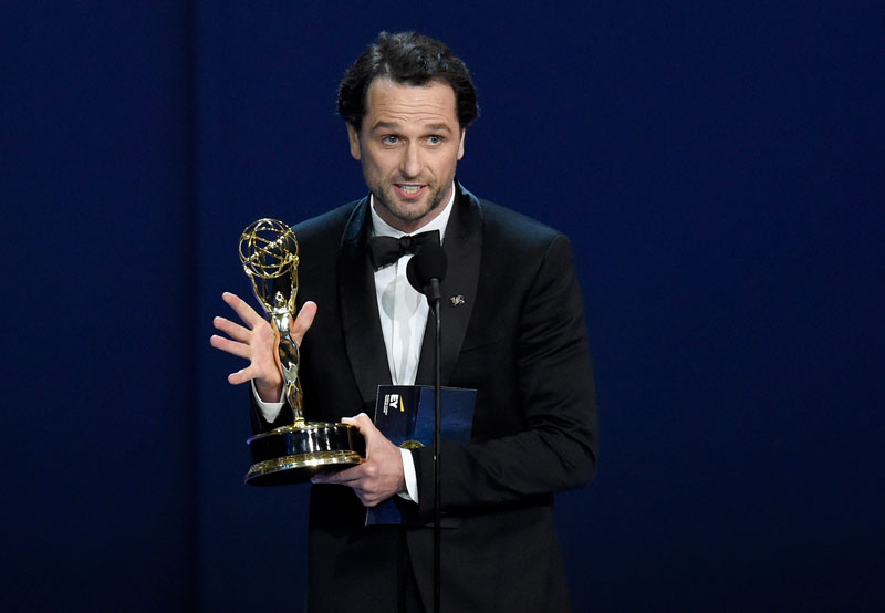 "<div class=""meta image-caption""><div class=""origin-logo origin-image ap""><span>AP</span></div><span class=""caption-text"">Matthew Rhys accepts the award for outstanding lead actor in a drama series for ""The Americans"" at the 70th Primetime Emmy Awards. (Photo by Chris Pizzello/Invision/AP)</span></div>"
