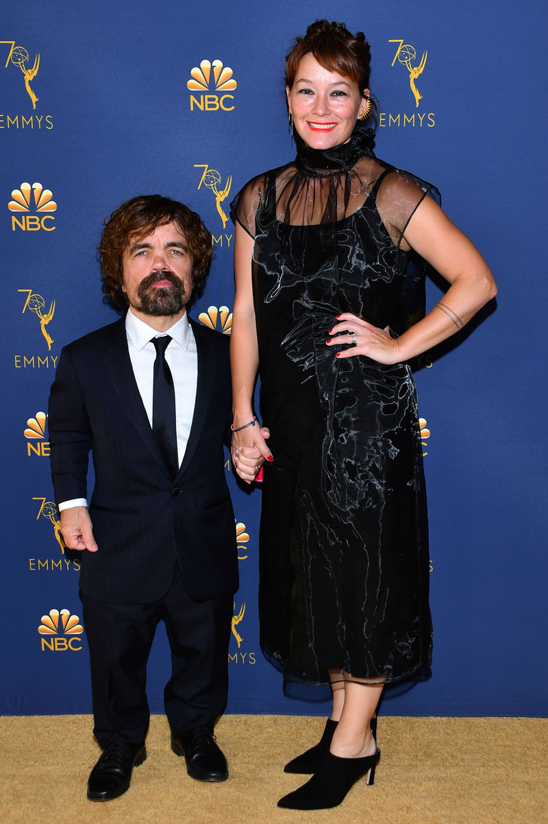 """<div class=""""meta image-caption""""><div class=""""origin-logo origin-image ap""""><span>AP</span></div><span class=""""caption-text"""">Peter Dinklage, left, Erica Schmidt arrive at the 70th Primetime Emmy Awards on Monday, Sept. 17, 2018, at the Microsoft Theater in Los Angeles. (Photo by Vince Bucci/Invision for the Television Academy/AP Images)</span></div>"""