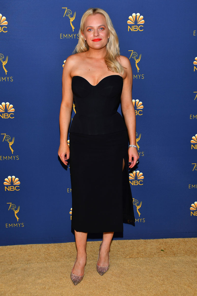 """<div class=""""meta image-caption""""><div class=""""origin-logo origin-image ap""""><span>AP</span></div><span class=""""caption-text"""">Elisabeth Moss arrives at the 70th Primetime Emmy Awards on Monday, Sept. 17, 2018, at the Microsoft Theater in Los Angeles. (Photo by Vince Bucci/Invision for the Television Academy/AP Images)</span></div>"""