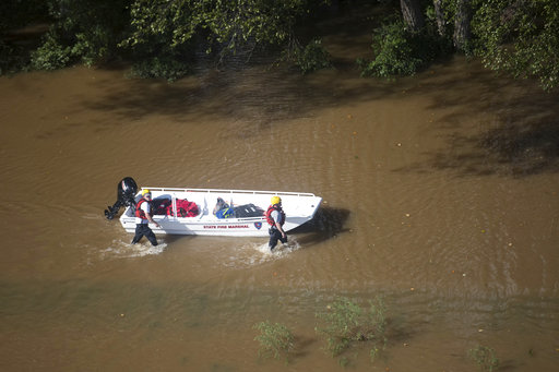 "<div class=""meta image-caption""><div class=""origin-logo origin-image ap""><span>AP</span></div><span class=""caption-text"">A rescue team pushes a boat towards stranded motorists after Hurricane Florence struck the Carolinas Monday, Sept. 17, 2018, near Wallace, S.C. (AP Photo/Sean Rayford)</span></div>"