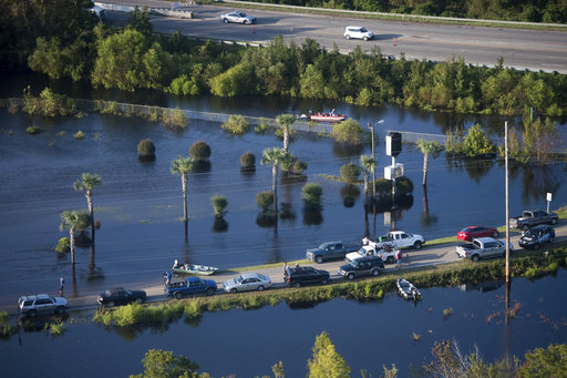 <div class='meta'><div class='origin-logo' data-origin='AP'></div><span class='caption-text' data-credit='AP Photo/Sean Rayford'>People use a road as a boat ramp after Hurricane Florence struck the Carolinas Monday, Sept. 17, 2018, in Conway, S.C.</span></div>