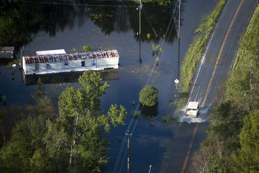 <div class='meta'><div class='origin-logo' data-origin='AP'></div><span class='caption-text' data-credit='AP Photo/Sean Rayford'>A truck drives through floodwaters after Hurricane Florence struck the Carolinas, Monday, Sept. 17, 2018, near Conway, S.C.</span></div>