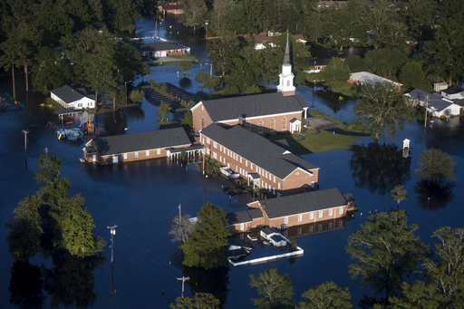<div class='meta'><div class='origin-logo' data-origin='AP'></div><span class='caption-text' data-credit='AP Photo/Sean Rayford'>Floodwaters inundate a church after Hurricane Florence struck the Carolinas Monday, Sept. 17, 2018, in Conway, S.C.</span></div>