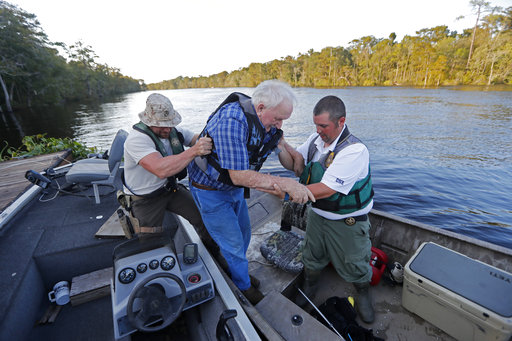 <div class='meta'><div class='origin-logo' data-origin='AP'></div><span class='caption-text' data-credit='AP Photo/Gerald Herbert'>William Larymore, right, and Salvatore Cirencione help resident Franklin Bessemer in Conway, S.C., Monday, Sept. 17, 2018.</span></div>