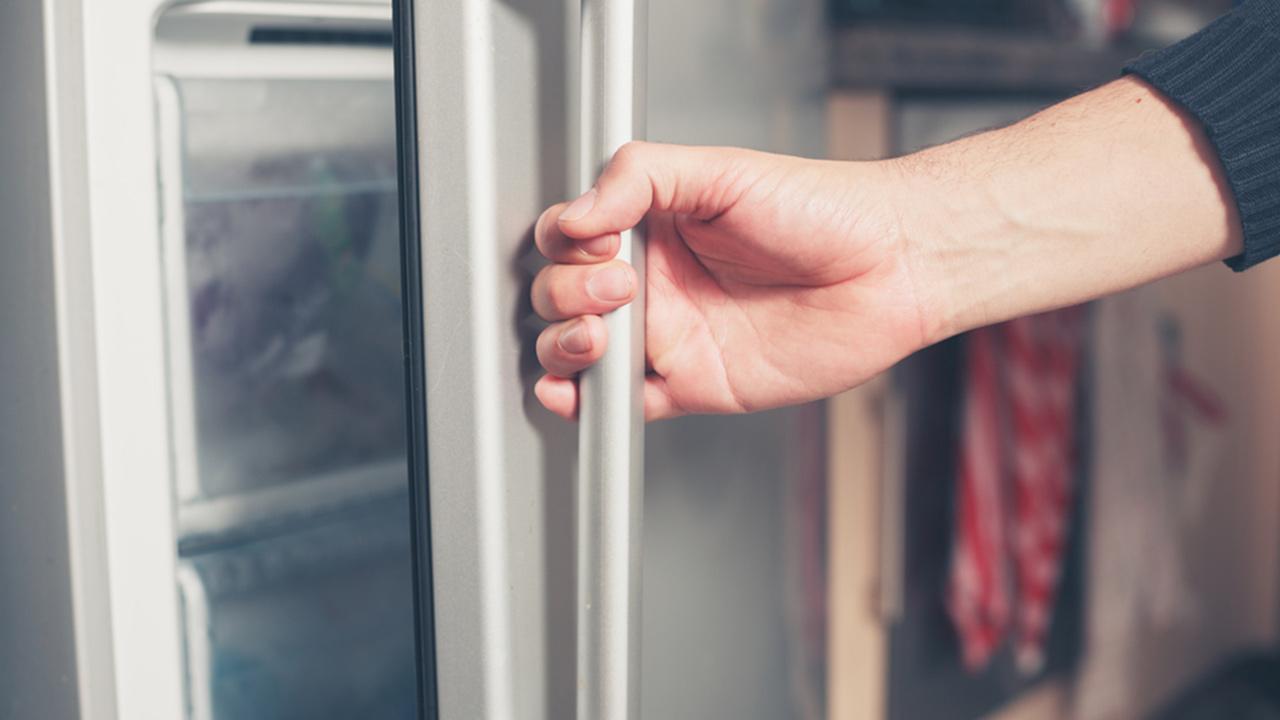 Opening a fridge