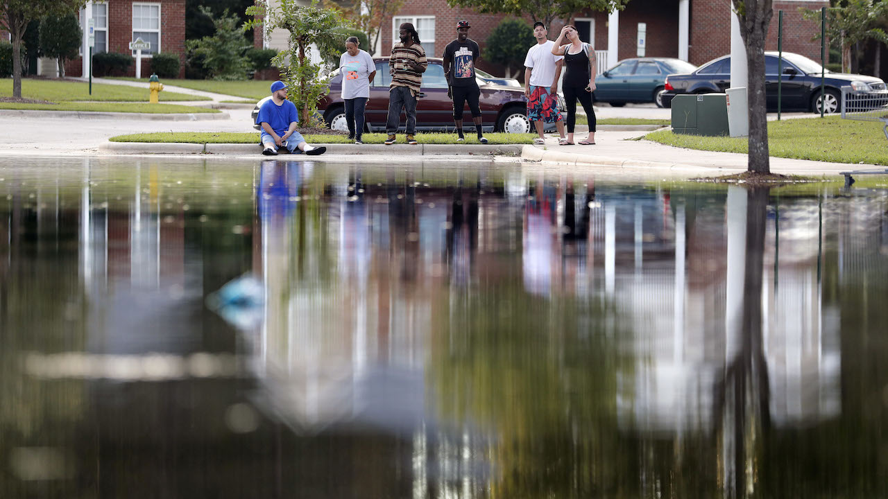 <div class='meta'><div class='origin-logo' data-origin='AP'></div><span class='caption-text' data-credit='AP Photo/David Goldman'>Residents look out at the flooded entrance to an apartment complex near the Cape Fear River as it continues to rise in the aftermath of Hurricane Florence.</span></div>