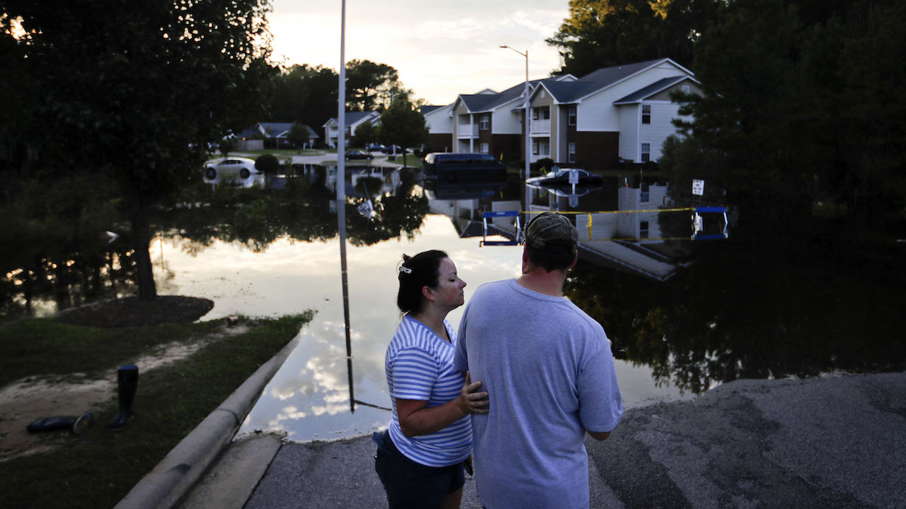 <div class='meta'><div class='origin-logo' data-origin='AP'></div><span class='caption-text' data-credit='AP Photo/David Goldman'>Hanna, left, and Eric Hadley stand at the flooded entrance to an apartment complex near the Cape Fear River as it continues to rise in the aftermath of Hurricane Florence.</span></div>
