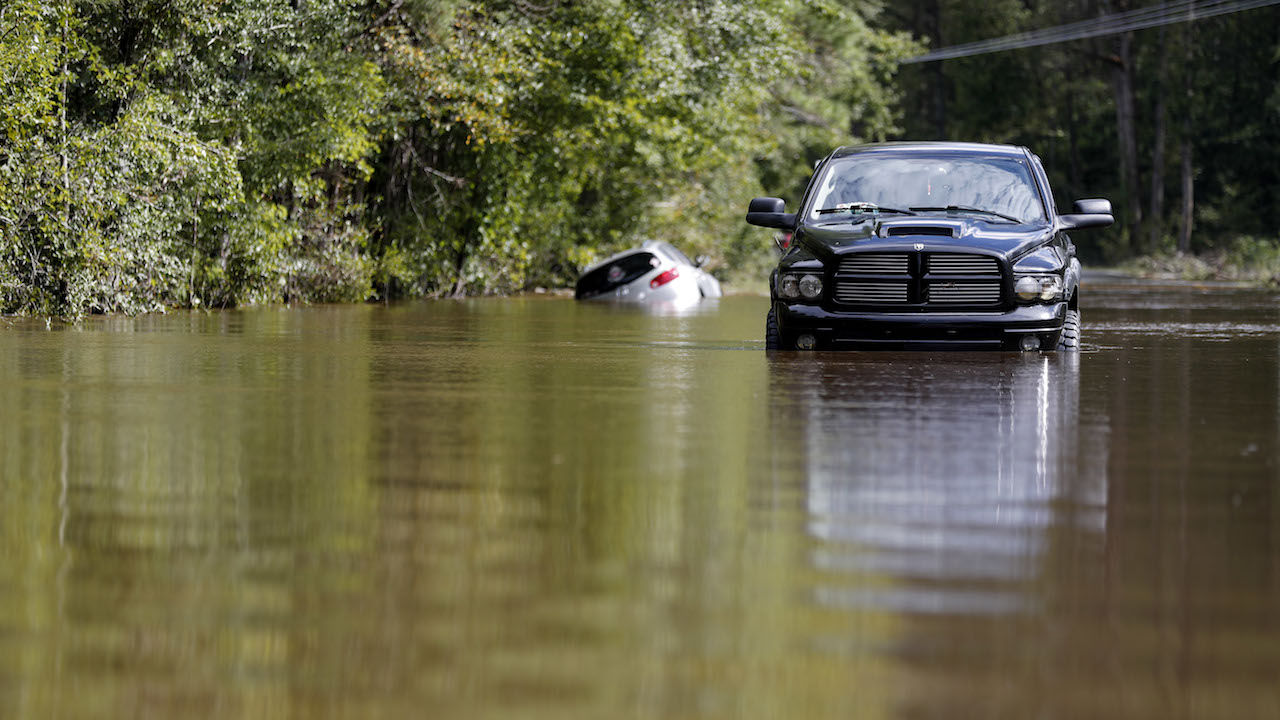 <div class='meta'><div class='origin-logo' data-origin='AP'></div><span class='caption-text' data-credit='AP Photo/David Goldman'>Cars sit abandoned on a flooded street in the aftermath of Hurricane Florence in Lillington, N.C., Tuesday, Sept. 18, 2018.</span></div>