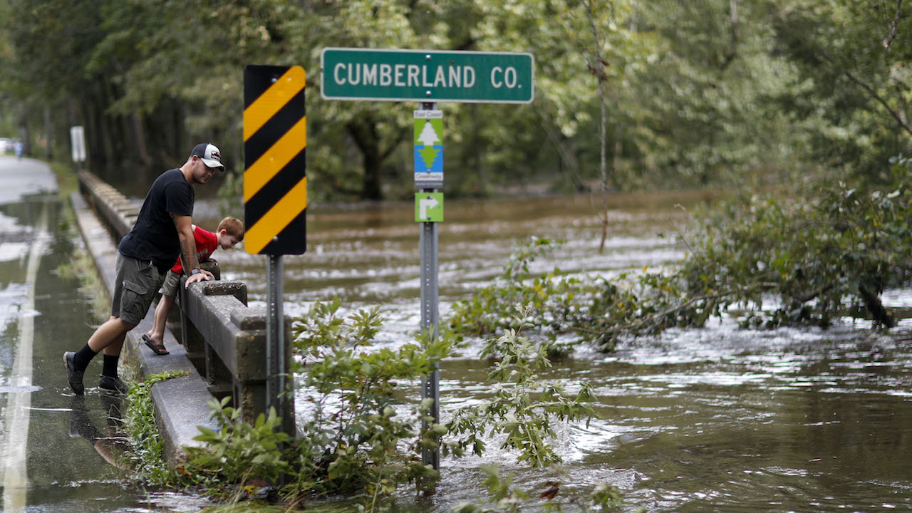 <div class='meta'><div class='origin-logo' data-origin='AP'></div><span class='caption-text' data-credit='AP Photo/David Goldman'>The waters of the Little River flow up against a bridge as it begins to recede making the road passable in the aftermath of Hurricane Florence in Fayetteville, NC, Sept. 18, 2018.</span></div>