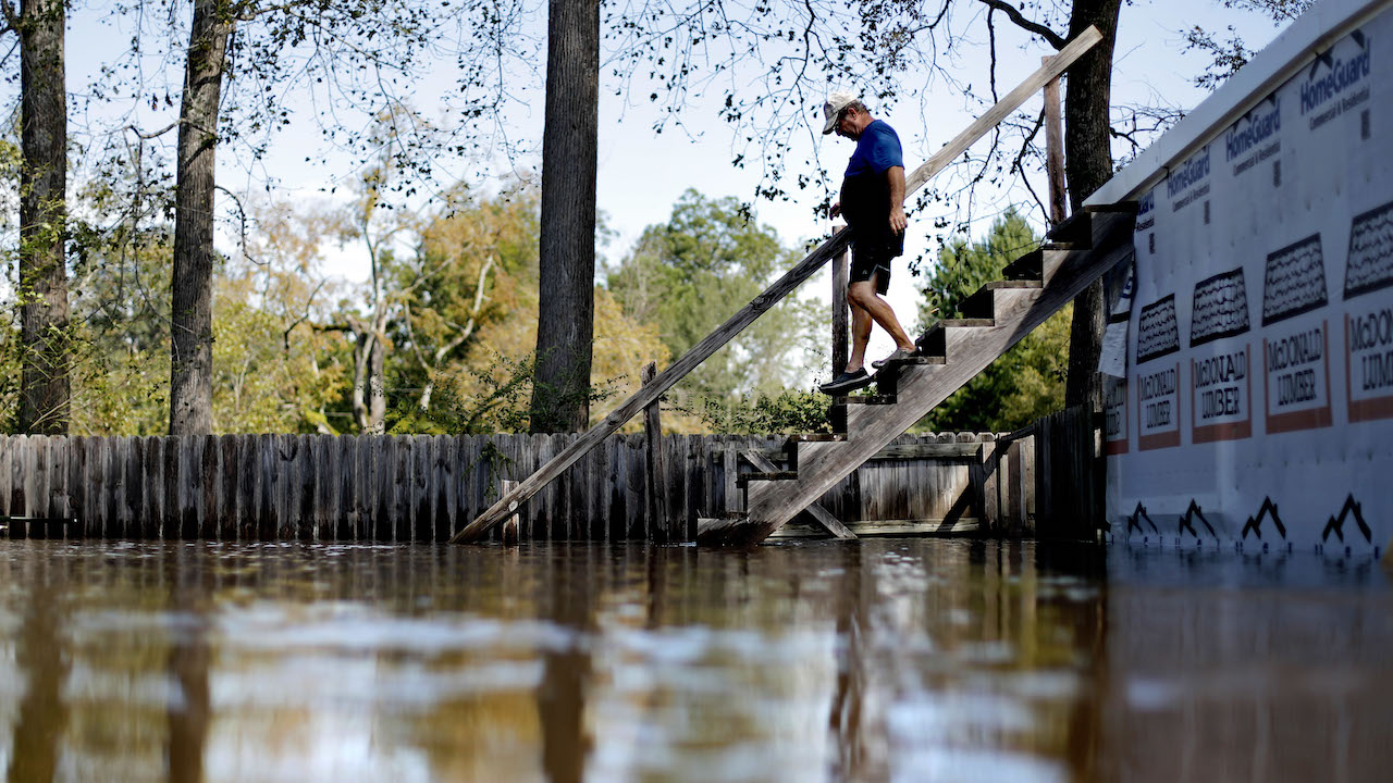 <div class='meta'><div class='origin-logo' data-origin='AP'></div><span class='caption-text' data-credit='AP Photo/David Goldman'>Kenny Babb walks down a staircase into the water on his flooded property as the Little River continues to rise after Hurricane Florence in Linden, N.C., Sept. 18, 2018.</span></div>