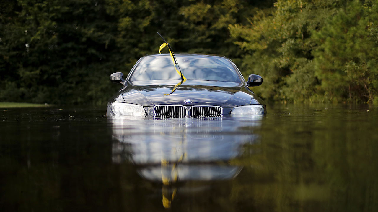 <div class='meta'><div class='origin-logo' data-origin='AP'></div><span class='caption-text' data-credit='AP Photo/David Goldman'>A car sits in a flooded parking lot at an apartment complex near the Cape Fear River as it continues to rise in the aftermath of Hurricane Florence in Fayetteville, N.C.</span></div>