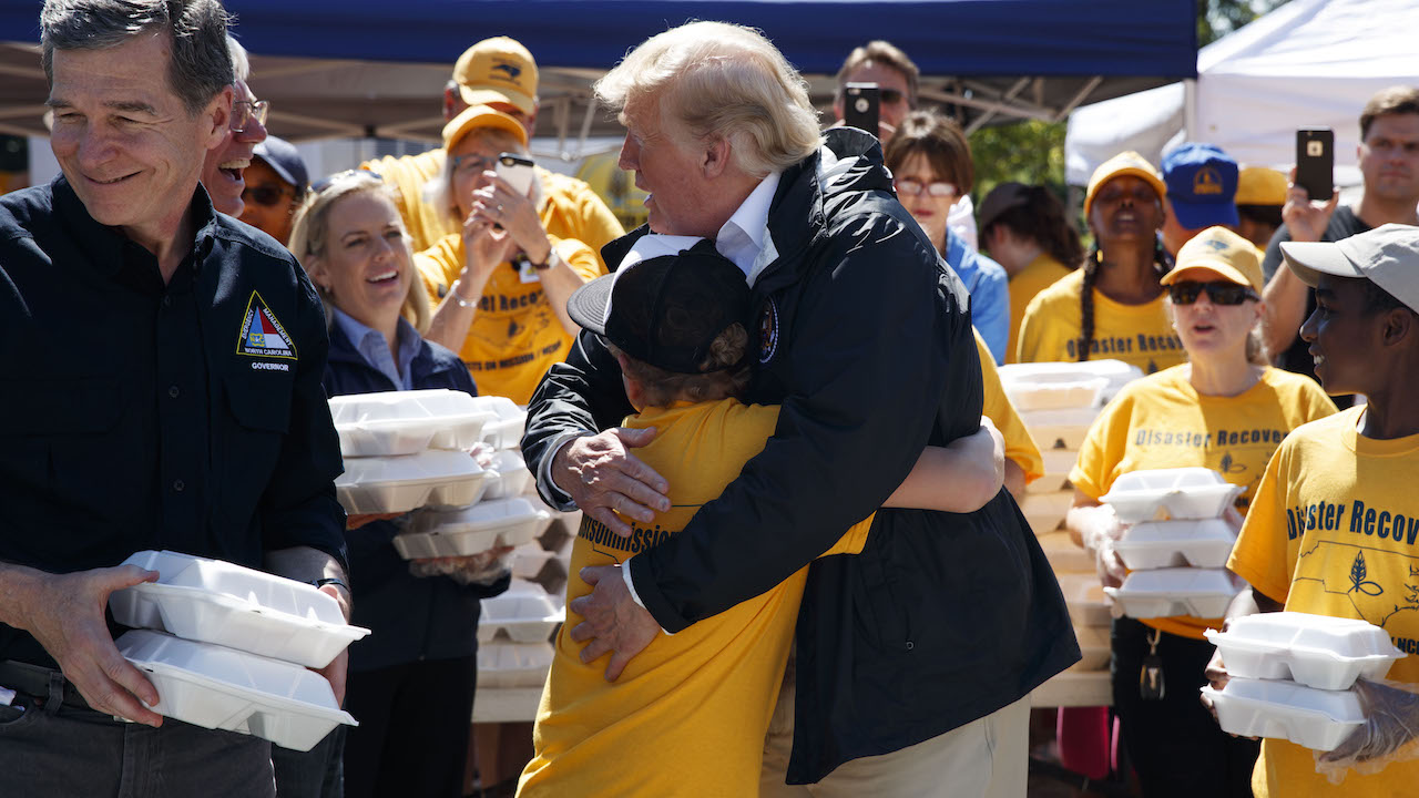 <div class='meta'><div class='origin-logo' data-origin='AP'></div><span class='caption-text' data-credit='AP'>President Donald Trump hugs a young man while handing out prepackaged meals at Temple Baptist Church in an area impacted by Hurricane Florence, Sept. 19, 2018, in New Bern, N.C.</span></div>