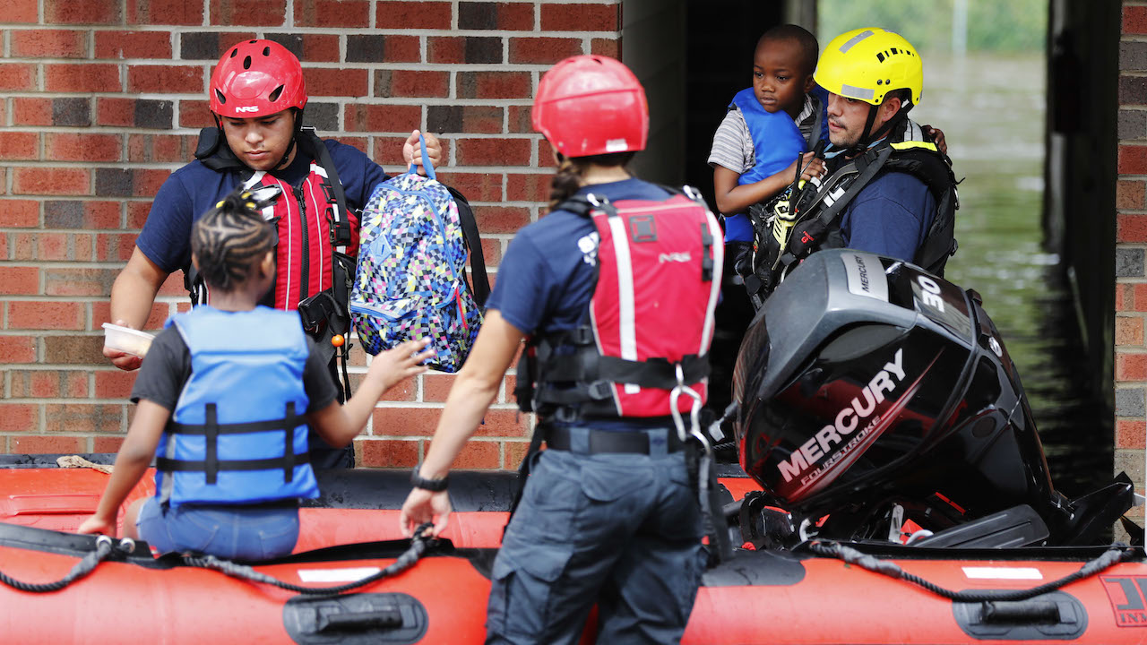 <div class='meta'><div class='origin-logo' data-origin='AP'></div><span class='caption-text' data-credit='AP Photo/David Goldman'>Rescue personnel evacuate residents as flooding continues in the aftermath of Hurricane Florence in Spring Lake, N.C., Monday, Sept. 17, 2018.</span></div>