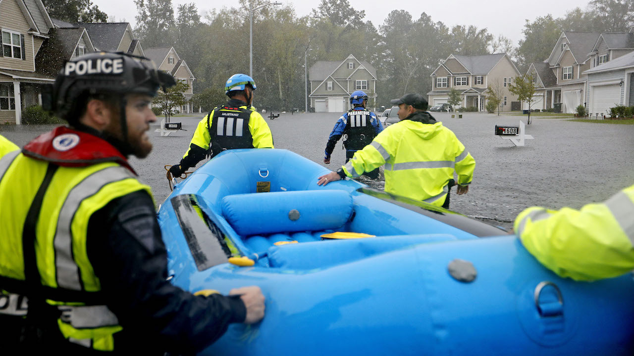<div class='meta'><div class='origin-logo' data-origin='AP'></div><span class='caption-text' data-credit='AP Photo/David Goldman'>First responders wade through a flooded neighborhood looking for residents who stayed behind as Florence continues to dump heavy rain in Fayetteville, N.C., Sunday, Sept. 16, 2018.</span></div>