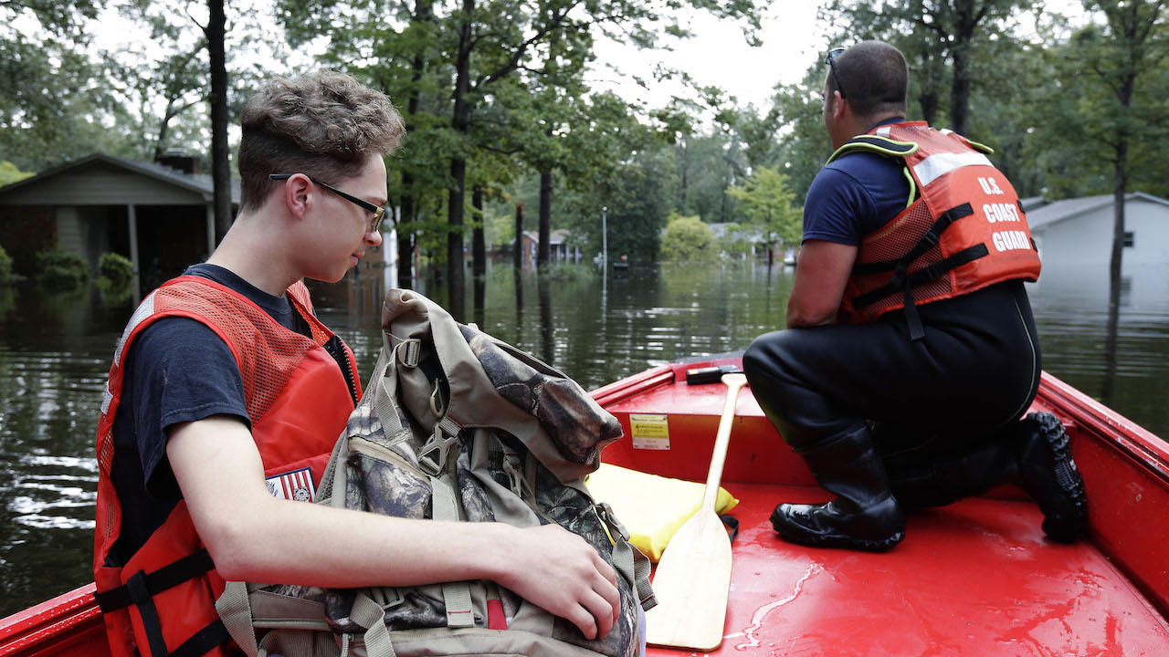 <div class='meta'><div class='origin-logo' data-origin='AP'></div><span class='caption-text' data-credit='AP Photo/Gerry Broome'>First responders remove resident Luke Luklee, left, from a flooded neighborhood in Lumberton, N.C., Monday, Sept. 17, 2018, in the aftermath of Hurricane Florence</span></div>