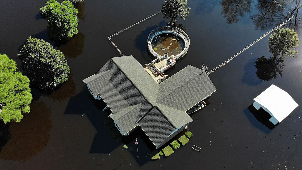<div class='meta'><div class='origin-logo' data-origin='Creative Content'></div><span class='caption-text' data-credit='Joe Raedle/Getty Images'>Flood waters isolate homes in the aftermath of Hurricane Florence September 19, 2018, in Lumberton, North Carolina.</span></div>
