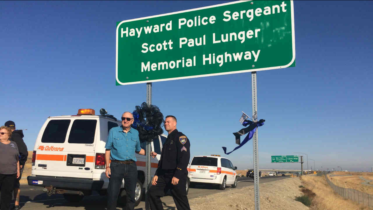 A sign for a stretch of Highway 4 named after Hayward Police Sergeant Scott Lunger is seen in Oakley, Calif. on Saturday, September 22, 2018.