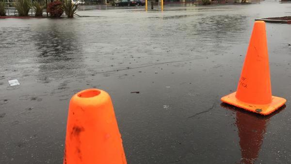 "<div class=""meta image-caption""><div class=""origin-logo origin-image ""><span></span></div><span class=""caption-text"">Flooding of parking lot forces closure of more than a dozen Linda Mar businesses on Thursday, Dec. 11, 2014. (ABC7 News)</span></div>"