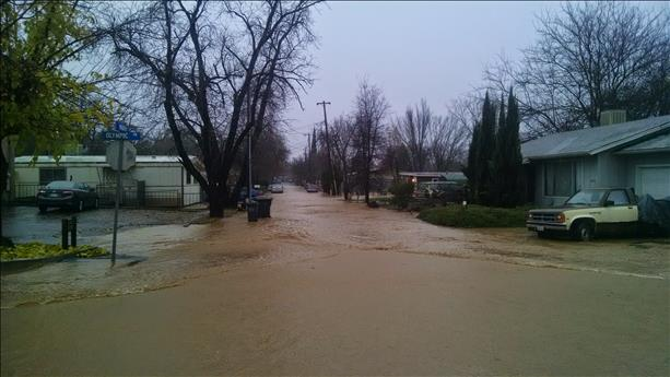 "<div class=""meta image-caption""><div class=""origin-logo origin-image ""><span></span></div><span class=""caption-text"">Flooding in Clearlake on Thursday, December 11, 2014 (Photo submitted by Ken M. via uReport) (uReport)</span></div>"