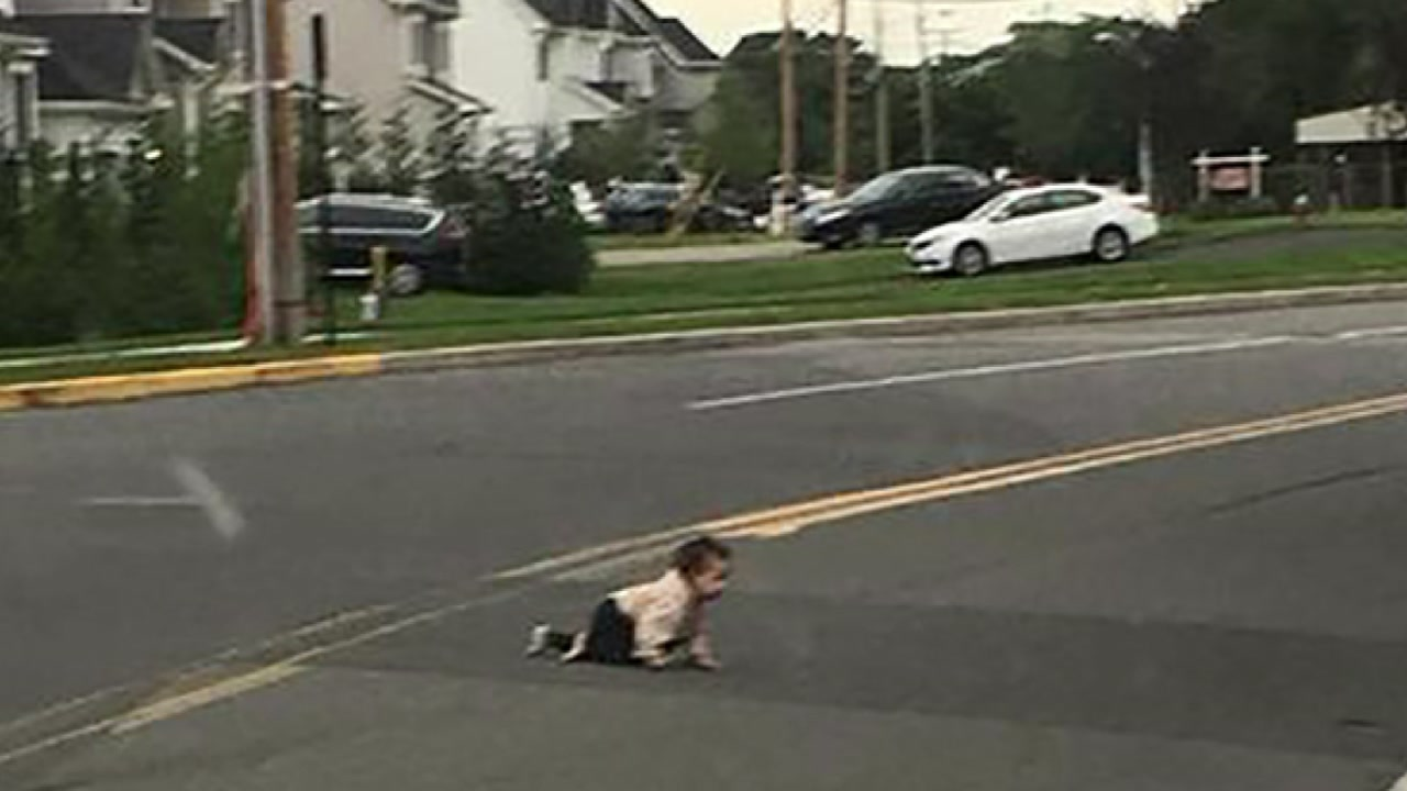Image result for toddler seen crawling on road in texas