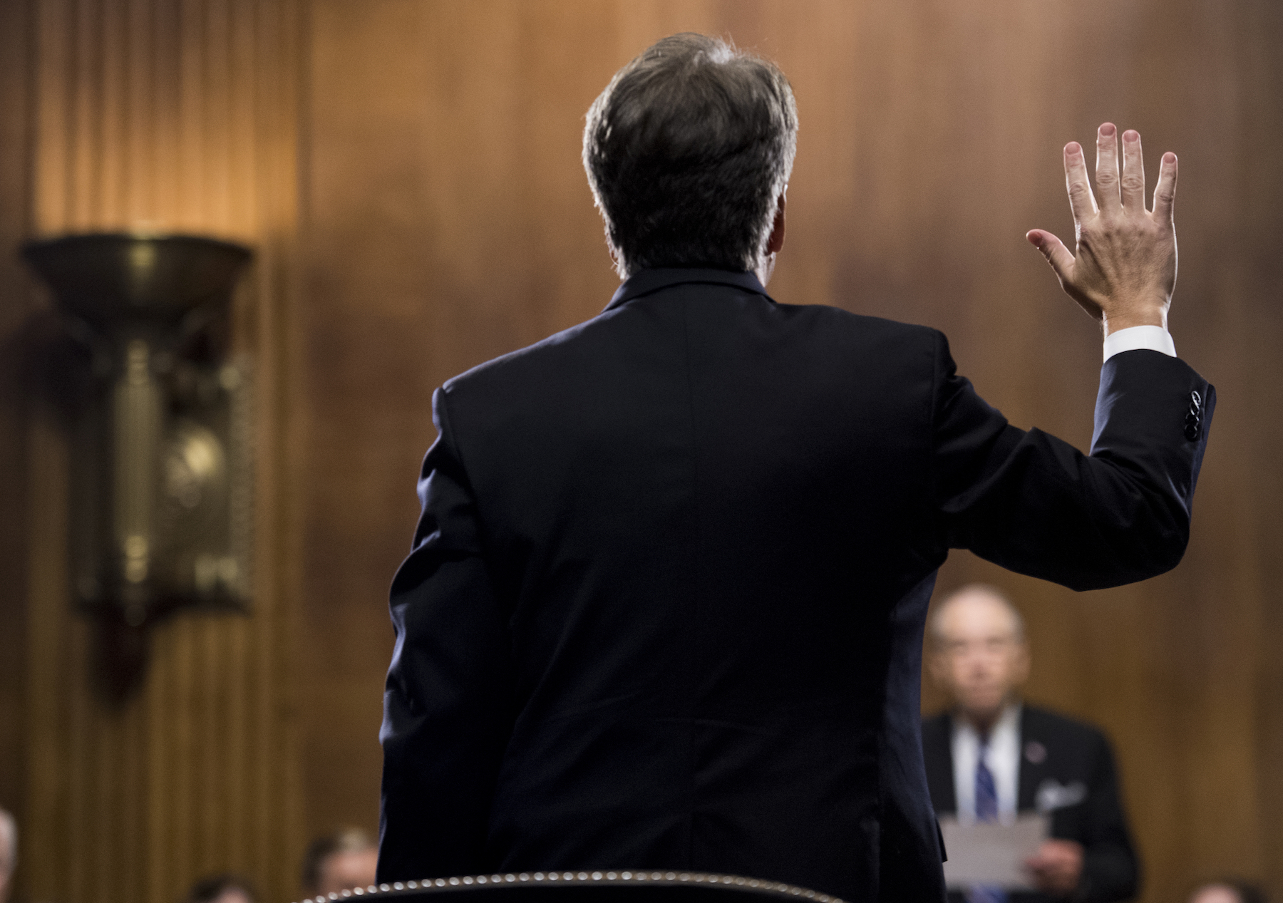 "<div class=""meta image-caption""><div class=""origin-logo origin-image ap""><span>AP</span></div><span class=""caption-text"">Brett Kavanaugh is sworn in before testifying during the Senate Judiciary Committee hearing on his nomination be an associate justice of the Supreme Court of the United States. (Tom Williams/CQ Roll Call/Pool)</span></div>"