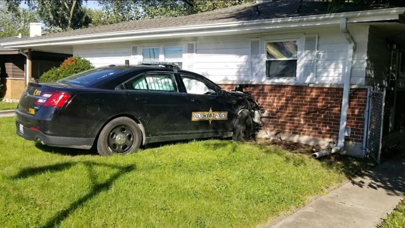 A Dolton police officer lost control of her squad car and crashed into a house Thursday.