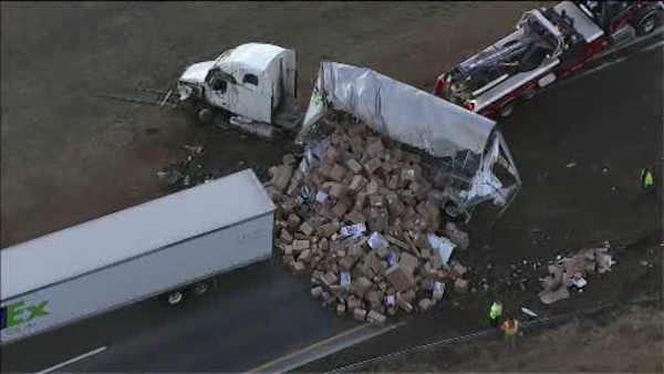 PHOTOS: FedEx truck crashes, spilling boxes onto highway
