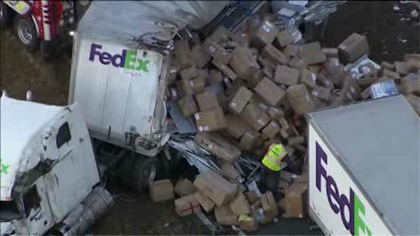 """<div class=""""meta image-caption""""><div class=""""origin-logo origin-image """"><span></span></div><span class=""""caption-text"""">A Fed Ex tractor trailer overturned Monday morning in Mahwah, spilling boxes and snarling traffic through the area.</span></div>"""