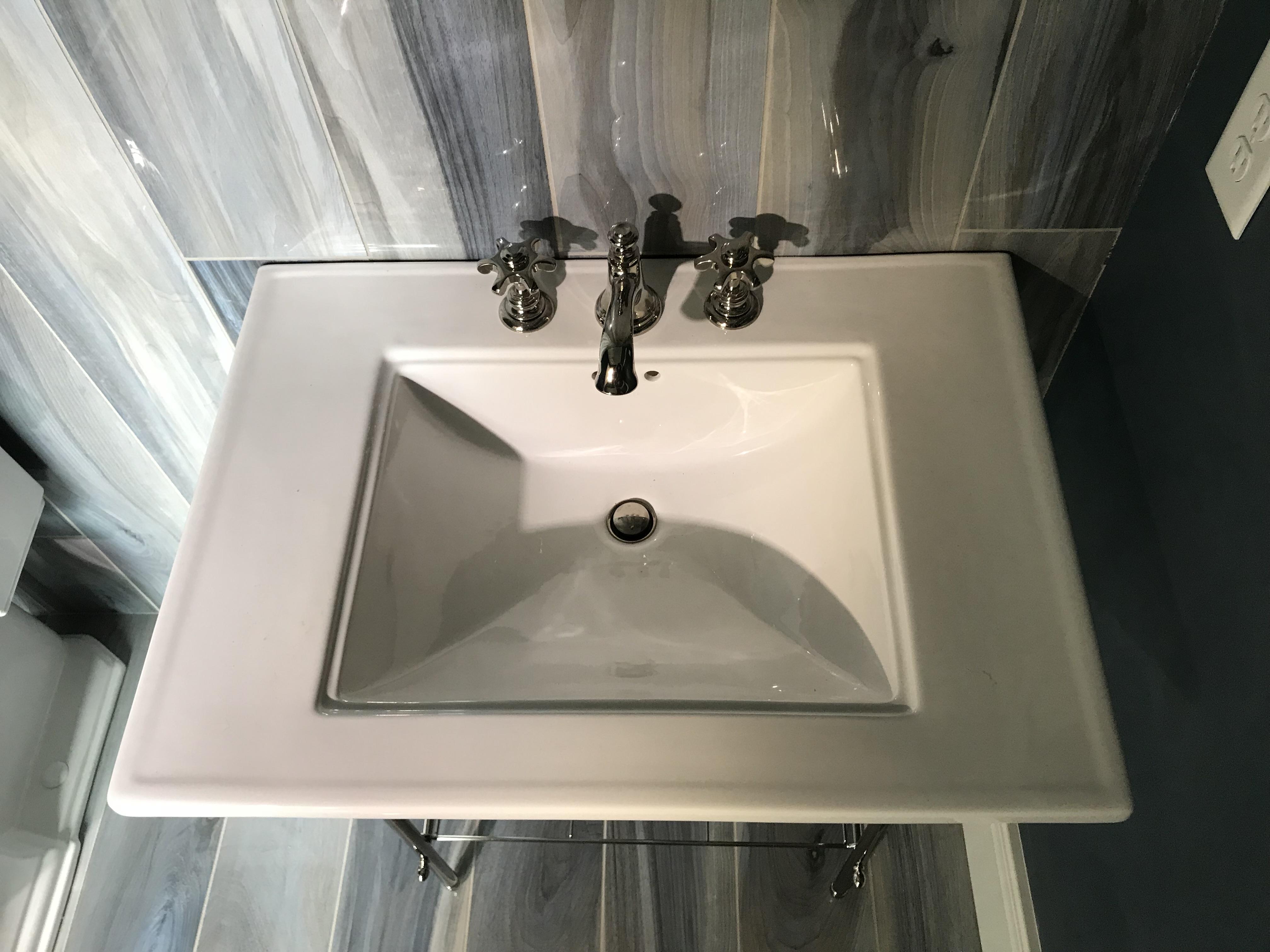<div class='meta'><div class='origin-logo' data-origin='WTVD'></div><span class='caption-text' data-credit=''>Master bath sink</span></div>