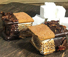 <div class='meta'><div class='origin-logo' data-origin='none'></div><span class='caption-text' data-credit='Credit: NC State Fair'>LaFarm Bakery: Candied Bacon S'more -- Marshmallow filled with applewood smoked bacon ganache and dipped in chocolate resting whole wheat cracker and topped with candied bacon.</span></div>