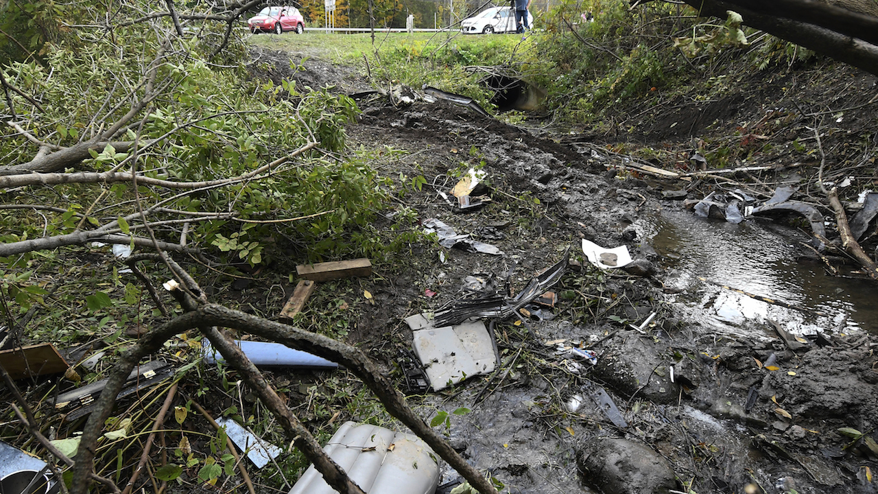 <div class='meta'><div class='origin-logo' data-origin='AP'></div><span class='caption-text' data-credit='AP Photo/Hans Pennink'>Debris scatters an area Sunday, Oct. 7, 2018, at the site of yesterday's fatal crash Schoharie, N.Y.</span></div>