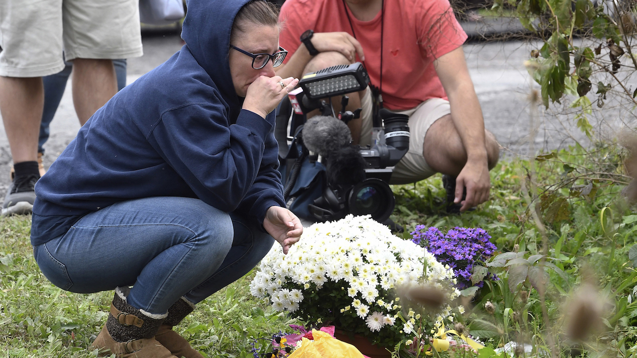 <div class='meta'><div class='origin-logo' data-origin='AP'></div><span class='caption-text' data-credit='AP Photo/Hans Pennink'>Friends of victims that died in a fatal limousine crash place flowers were 20 people died at the intersection on Route 30 and 30 A on Oct. 6, 2018.</span></div>