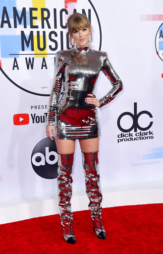 "<div class=""meta image-caption""><div class=""origin-logo origin-image none""><span>none</span></div><span class=""caption-text"">Taylor Swift arrives at the American Music Awards on Tuesday, Oct. 9, 2018, at the Microsoft Theater in Los Angeles. (Jordan Strauss/Invision/AP)</span></div>"