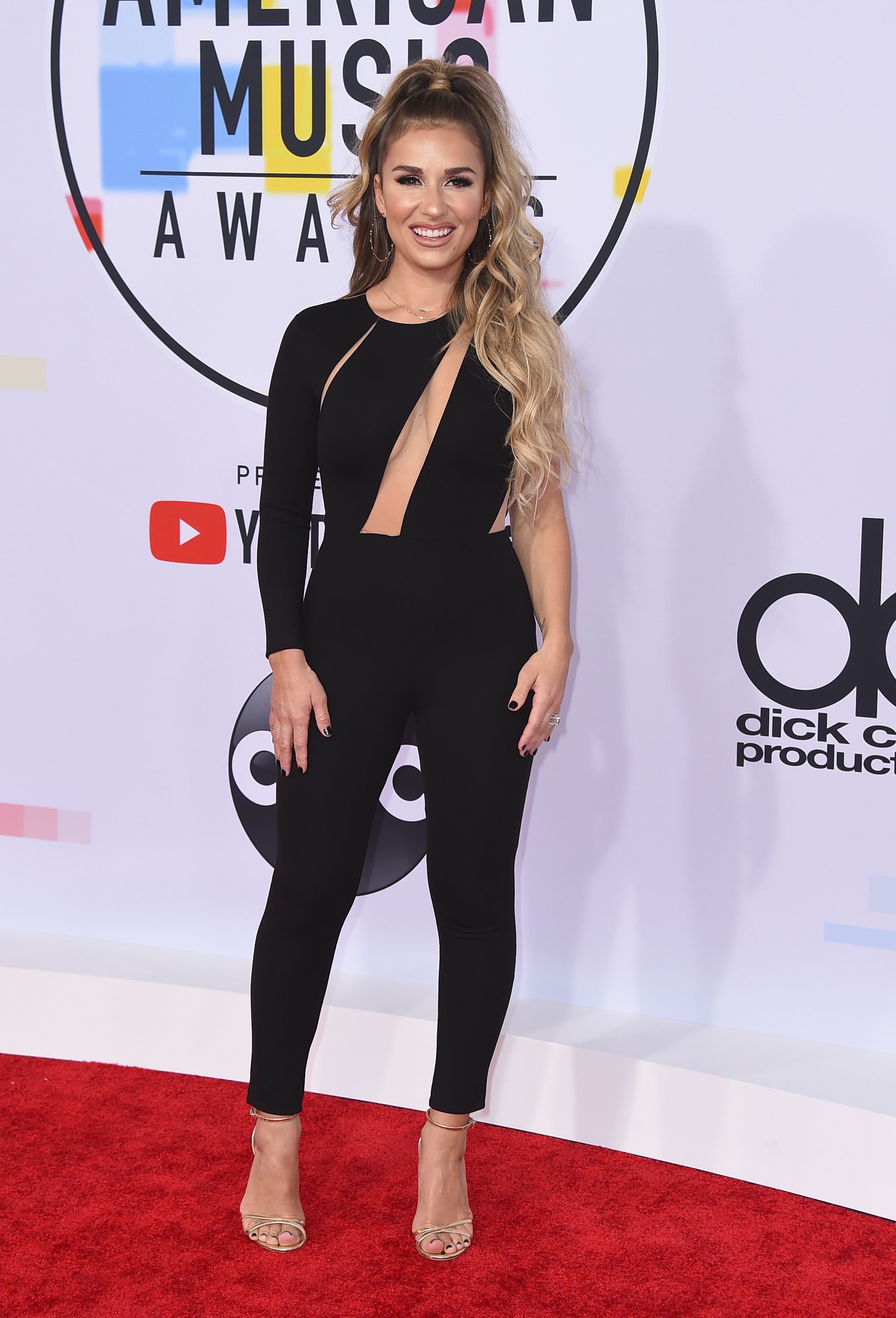 "<div class=""meta image-caption""><div class=""origin-logo origin-image none""><span>none</span></div><span class=""caption-text"">Jessie James Decker arrives at the American Music Awards on Tuesday, Oct. 9, 2018, at the Microsoft Theater in Los Angeles. (Photo by Jordan Strauss/Invision/AP)</span></div>"