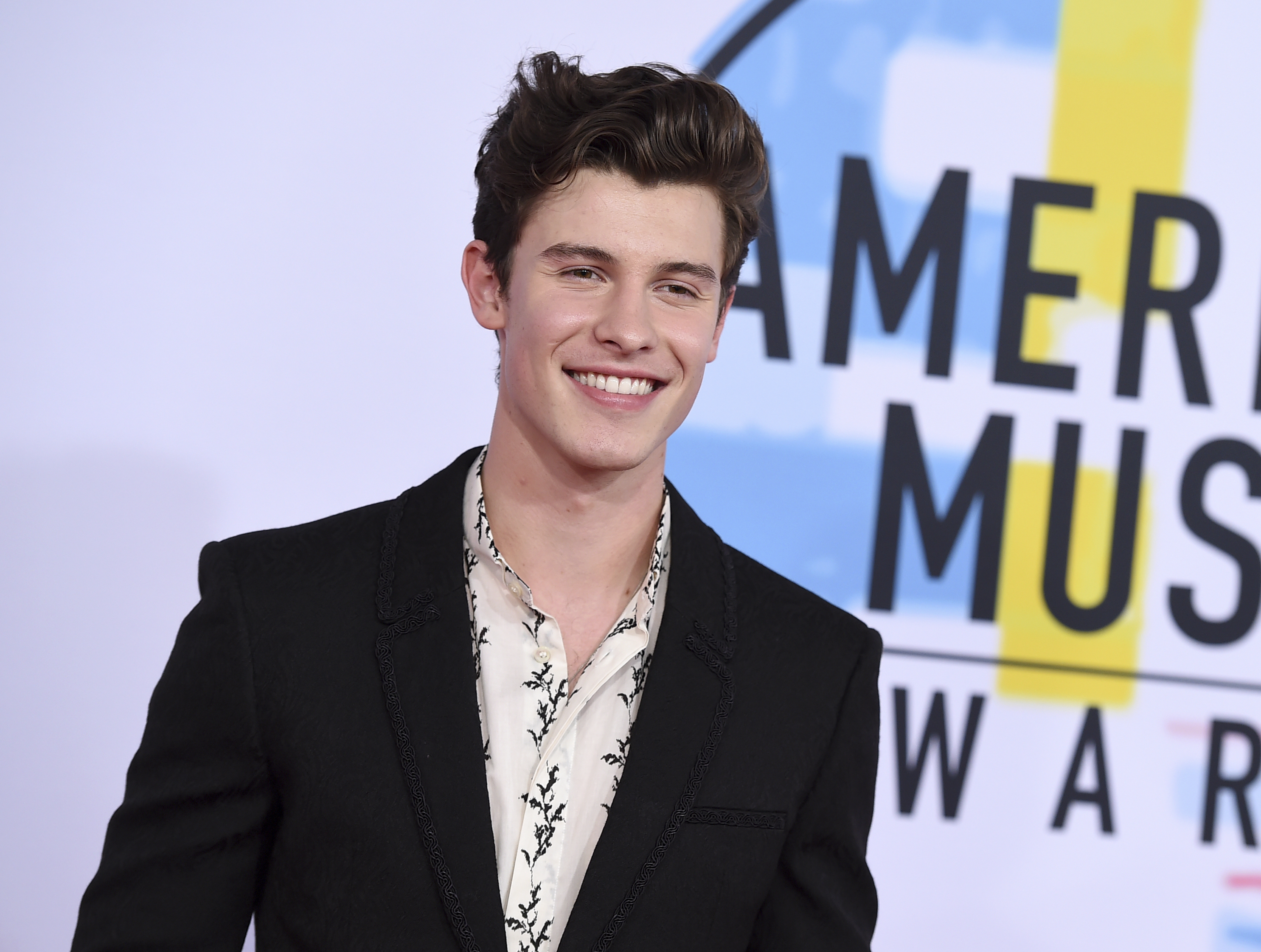 "<div class=""meta image-caption""><div class=""origin-logo origin-image none""><span>none</span></div><span class=""caption-text"">Shawn Mendes arrives at the American Music Awards on Tuesday, Oct. 9, 2018, at the Microsoft Theater in Los Angeles. (Jordan Strauss/Invision/AP)</span></div>"