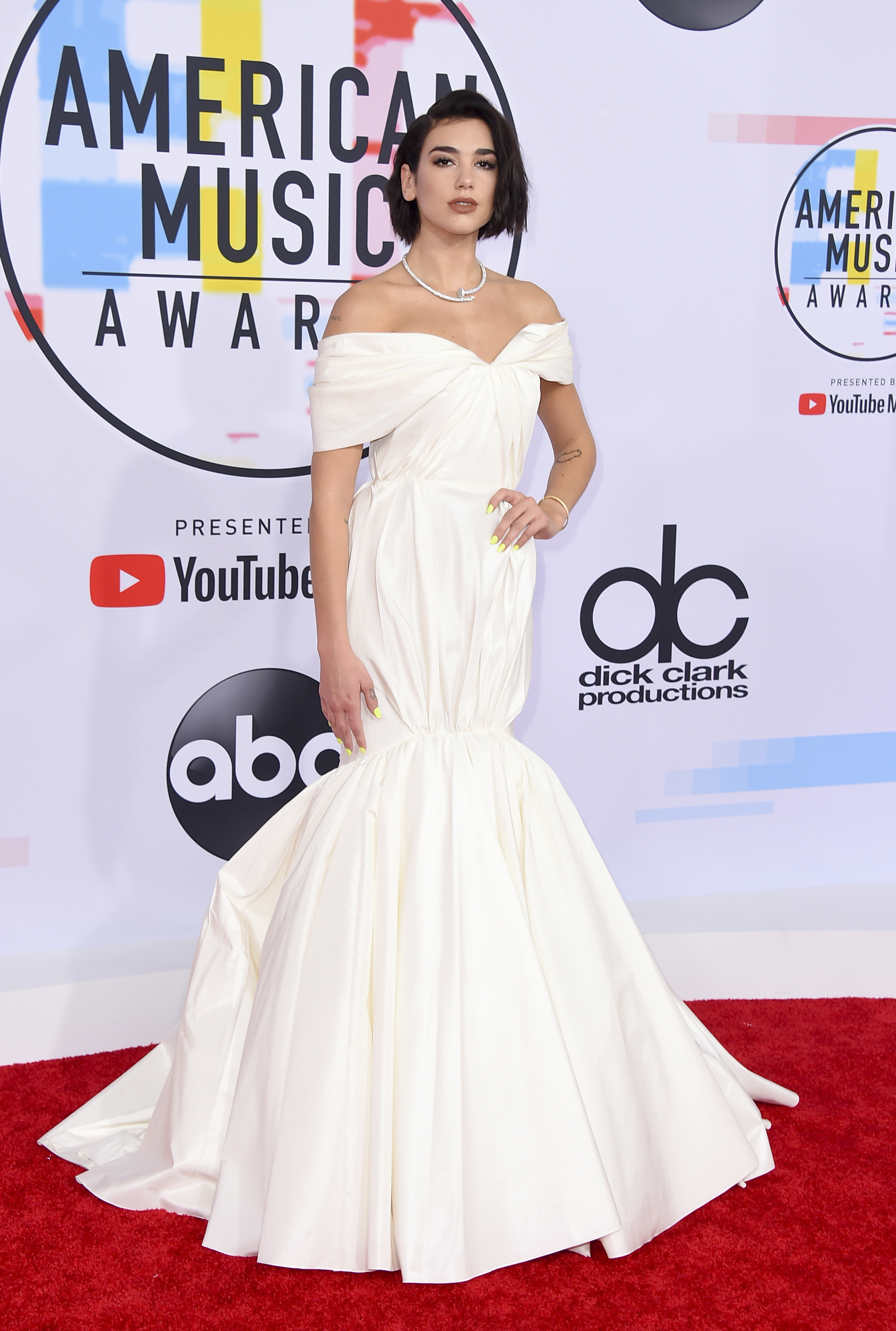 "<div class=""meta image-caption""><div class=""origin-logo origin-image none""><span>none</span></div><span class=""caption-text"">Dua Lipa arrives at the American Music Awards on Tuesday, Oct. 9, 2018, at the Microsoft Theater in Los Angeles. (Photo by Jordan Strauss/Invision/AP) (Jordan Strauss/Invision/AP)</span></div>"