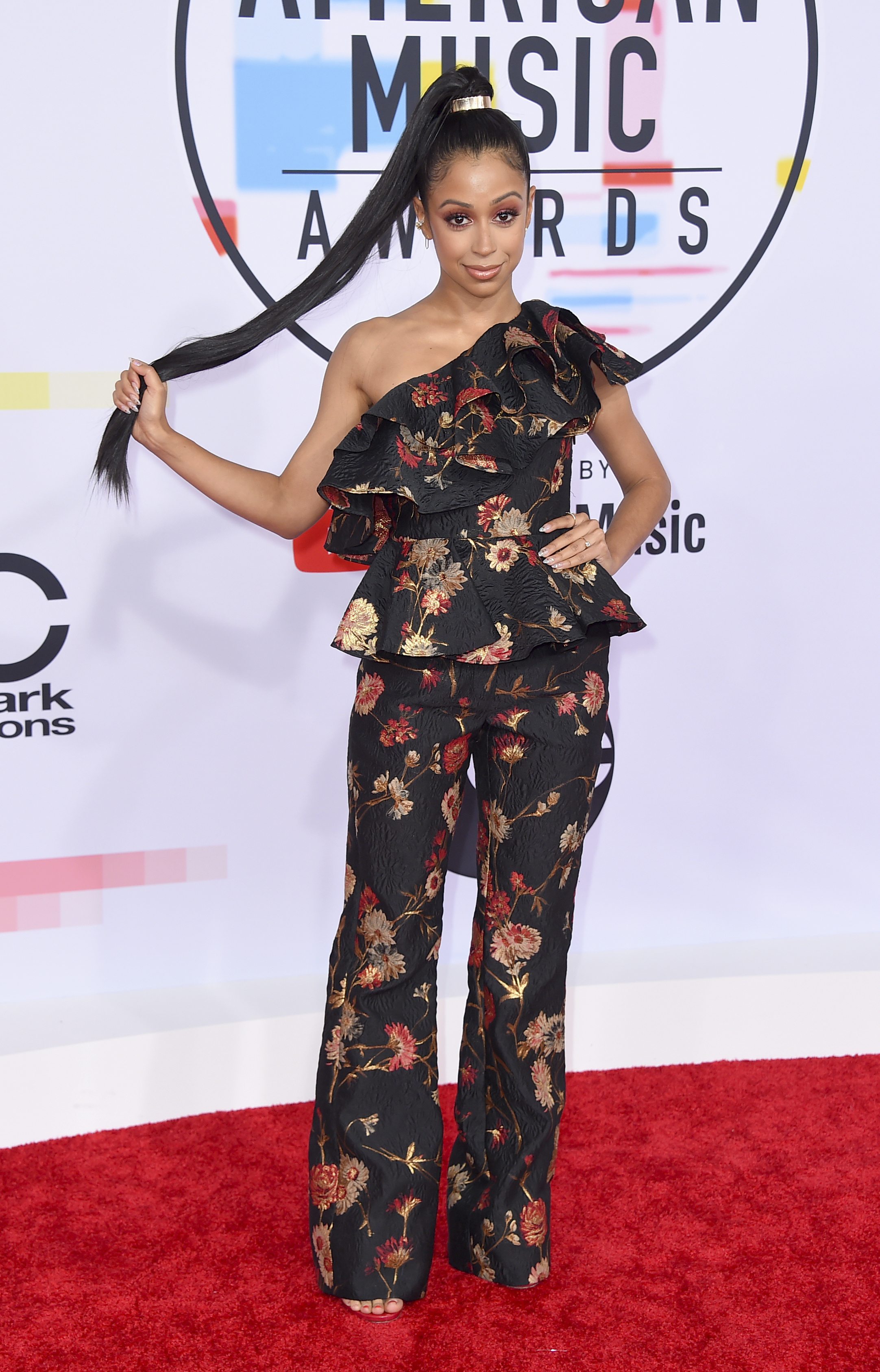 "<div class=""meta image-caption""><div class=""origin-logo origin-image none""><span>none</span></div><span class=""caption-text"">Liza Koshy arrives at the American Music Awards on Tuesday, Oct. 9, 2018, at the Microsoft Theater in Los Angeles. (Photo by Jordan Strauss/Invision/AP) (Jordan Strauss/Invision/AP)</span></div>"