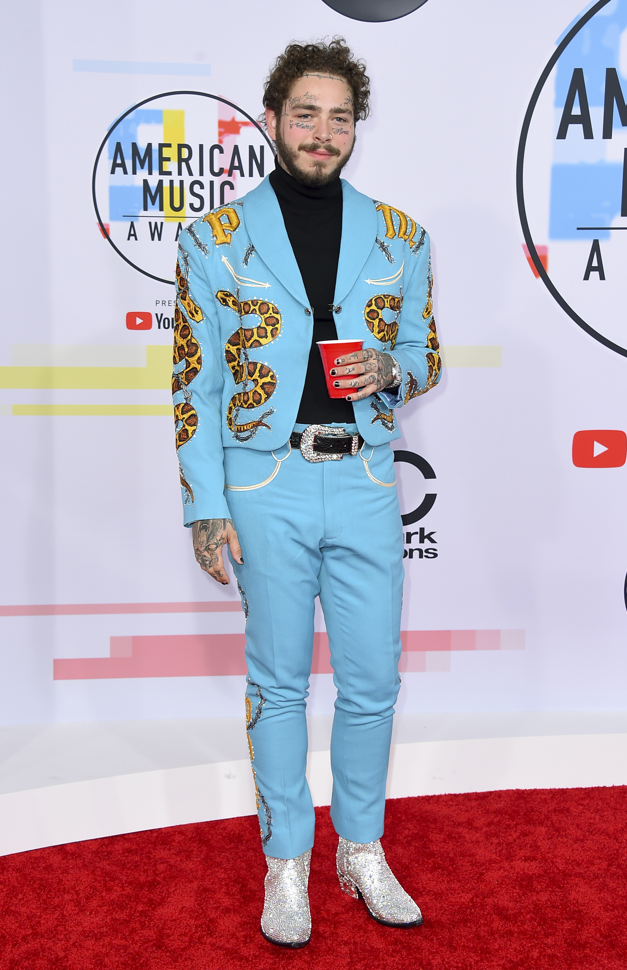 "<div class=""meta image-caption""><div class=""origin-logo origin-image none""><span>none</span></div><span class=""caption-text"">Post Malone arrives at the American Music Awards on Tuesday, Oct. 9, 2018, at the Microsoft Theater in Los Angeles. (Jordan Strauss/Invision/AP)</span></div>"