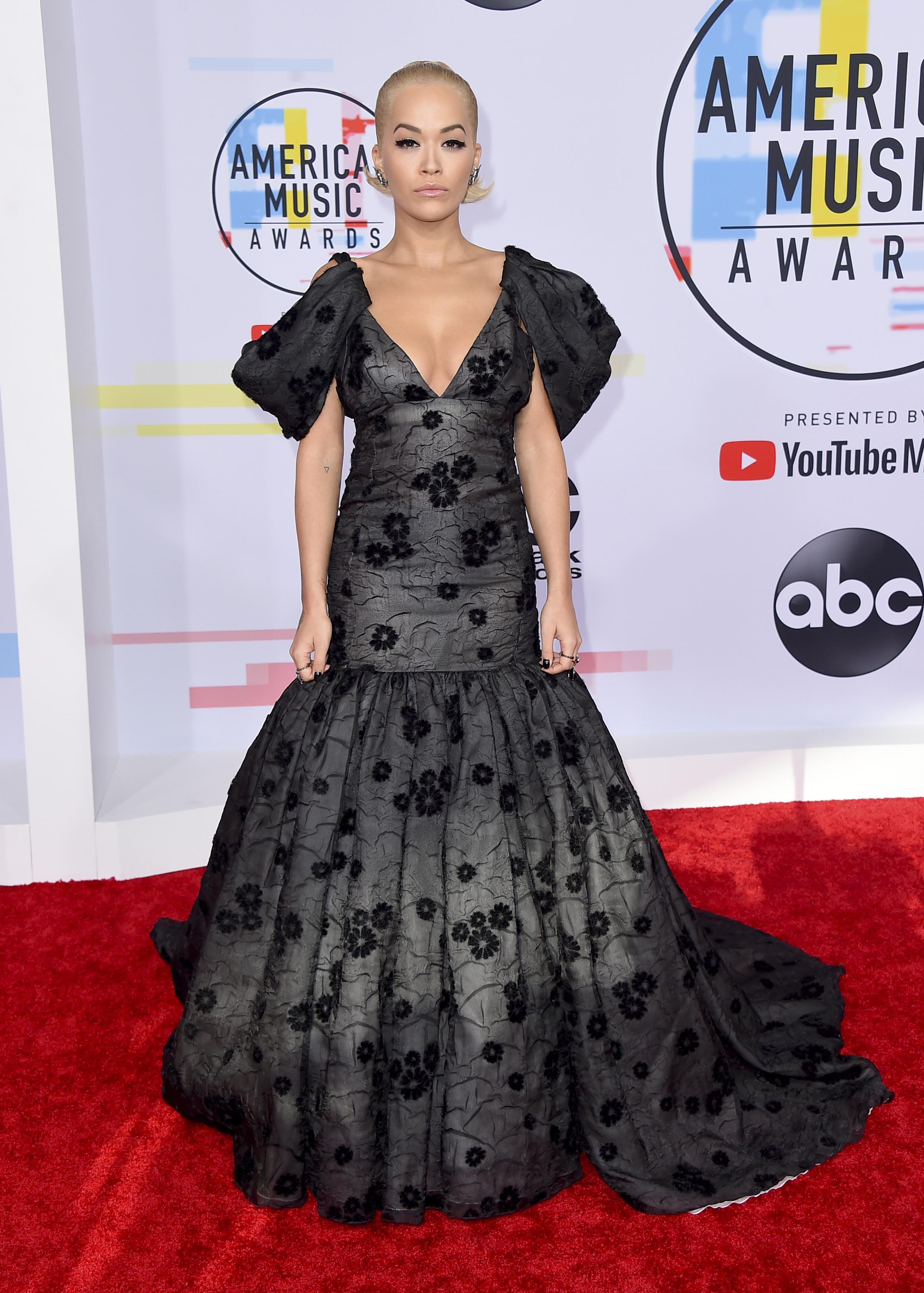 "<div class=""meta image-caption""><div class=""origin-logo origin-image none""><span>none</span></div><span class=""caption-text"">Rita Ora arrives at the American Music Awards on Tuesday, Oct. 9, 2018, at the Microsoft Theater in Los Angeles. (Jordan Strauss/Invision/AP)</span></div>"