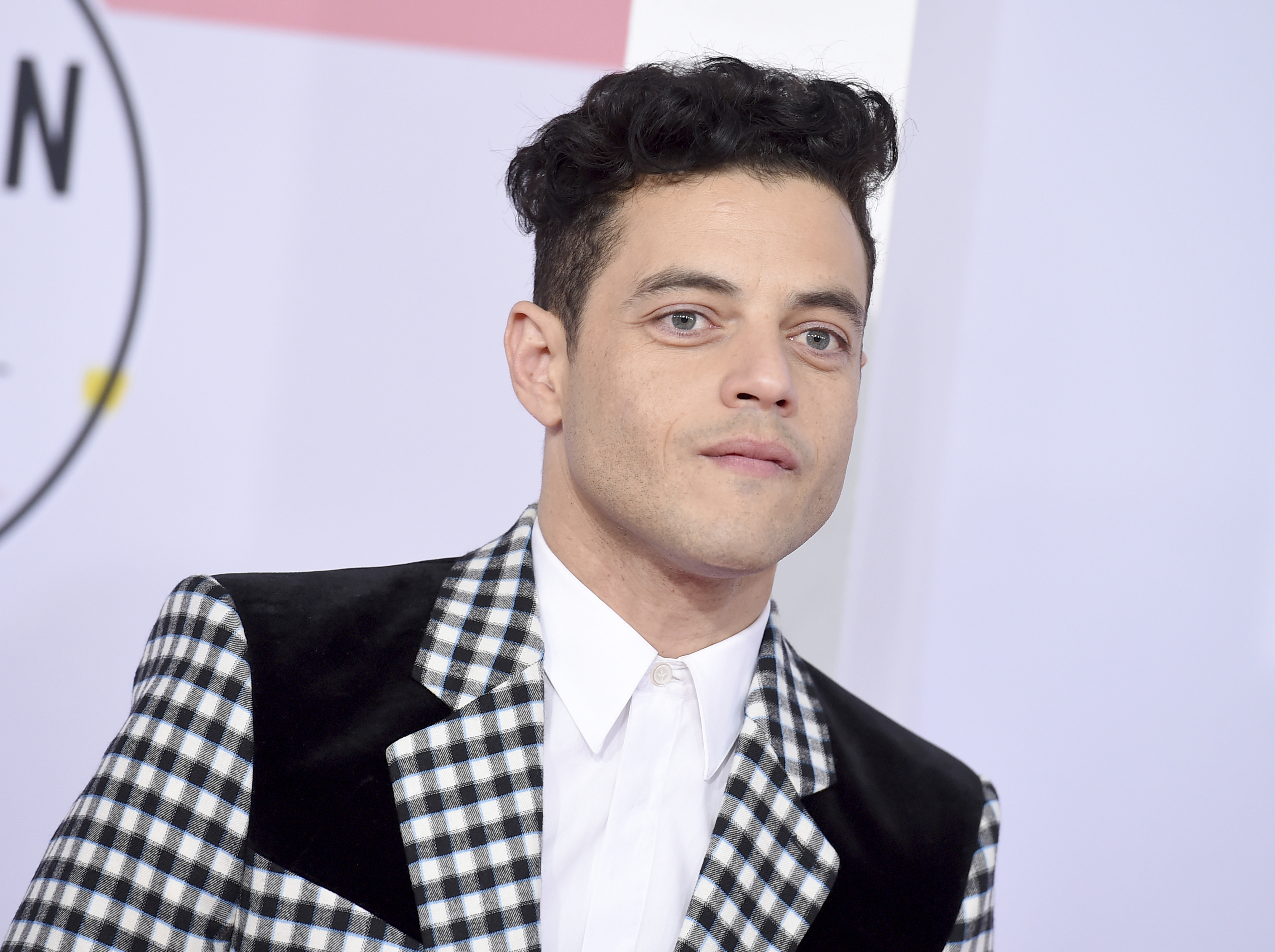 "<div class=""meta image-caption""><div class=""origin-logo origin-image none""><span>none</span></div><span class=""caption-text"">Rami Malek arrives at the American Music Awards on Tuesday, Oct. 9, 2018, at the Microsoft Theater in Los Angeles. (Jordan Strauss/Invision/AP)</span></div>"