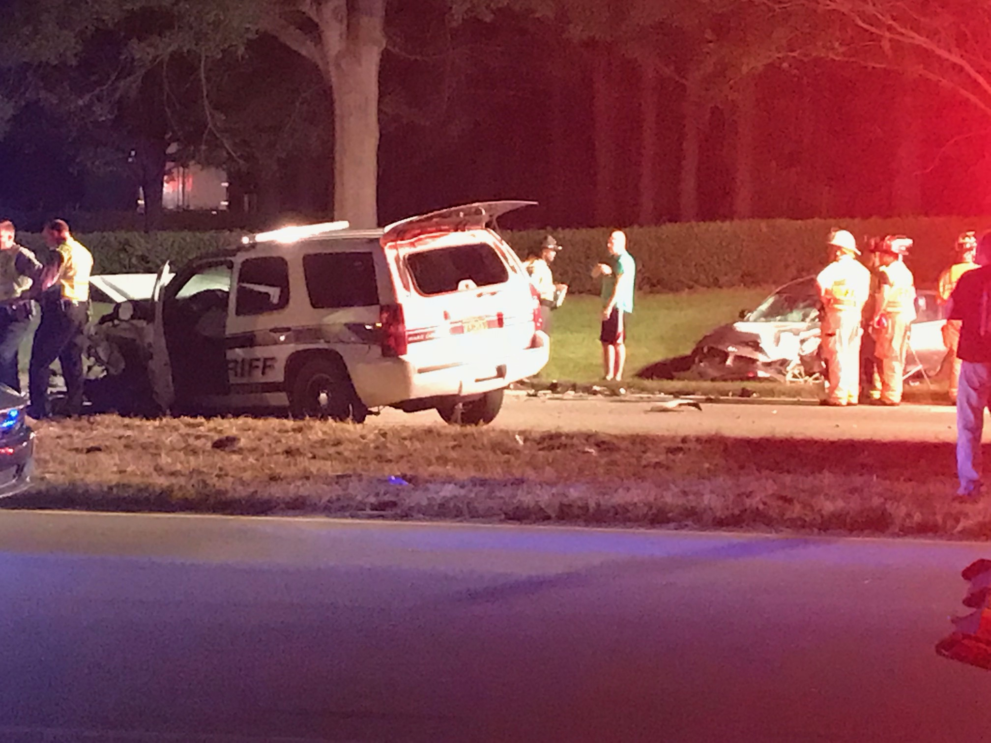 """<div class=""""meta image-caption""""><div class=""""origin-logo origin-image wtvd""""><span>WTVD</span></div><span class=""""caption-text"""">Emergency crews respond to the scene of a two-vehicle crash that left a Wake County deputy and another driver injured Tuesday night. (Robert Judson)</span></div>"""
