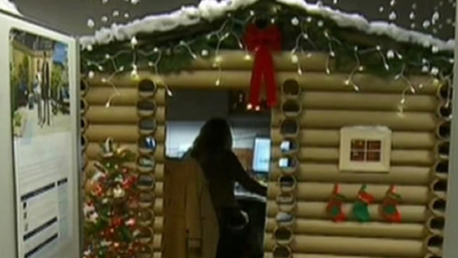 Woman transforms cubicle into holiday themed log cabin, wins company ...
