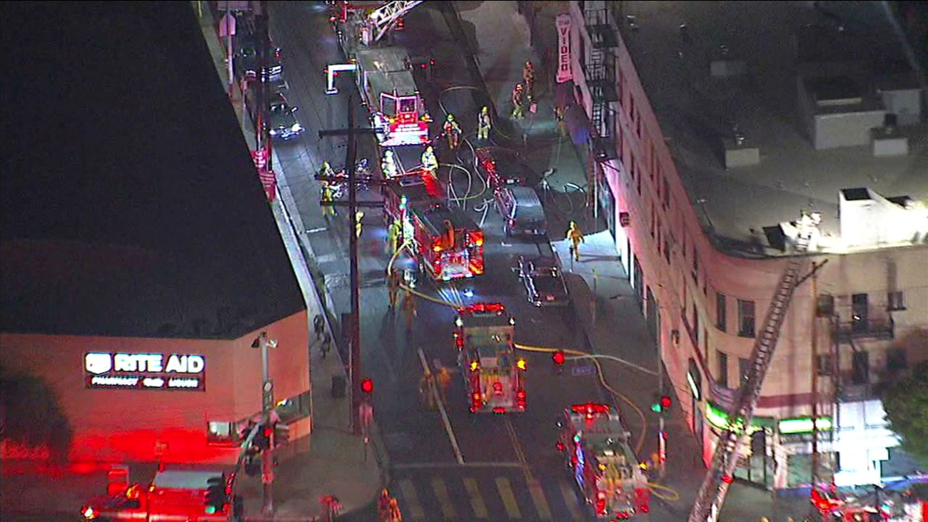 Fire damaged an apartment building in Lincoln Heights and one person was being treated for injuries, officials said.