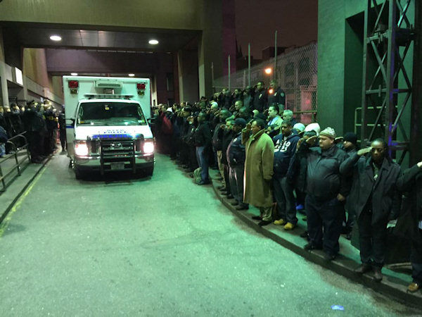 "<div class=""meta image-caption""><div class=""origin-logo origin-image ""><span></span></div><span class=""caption-text"">Hundreds of NYPD officers line streets to honor 2 fallen officers on Saturday, December 20, 2014.</span></div>"
