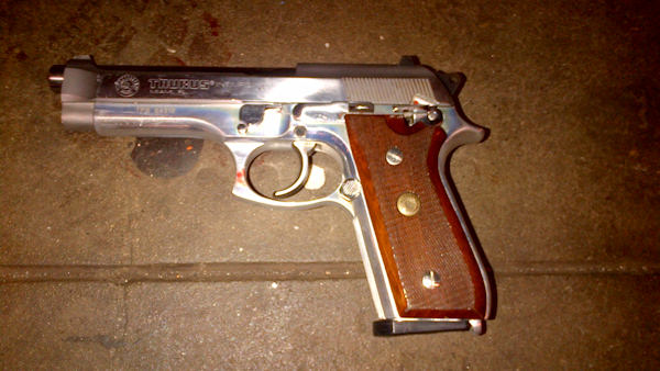 "<div class=""meta image-caption""><div class=""origin-logo origin-image ""><span></span></div><span class=""caption-text"">A silver semi-automatic Taurus firearm was recovered on the subway platform near the suspect's body.</span></div>"