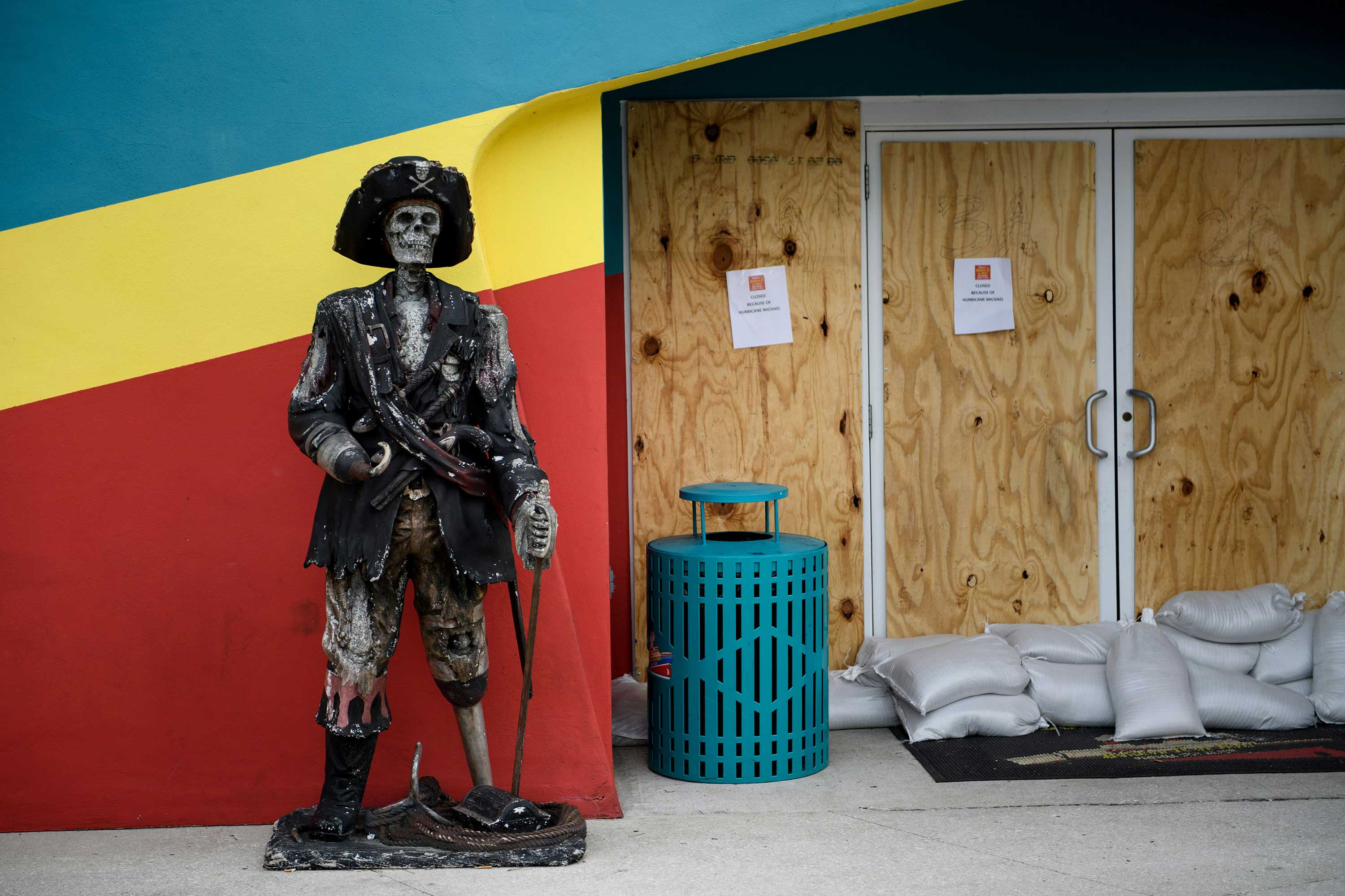 <div class='meta'><div class='origin-logo' data-origin='none'></div><span class='caption-text' data-credit='BRENDAN SMIALOWSKI/AFP/Getty Images'>A tourist attraction is seen with its doors boarded up to offer protection from Hurricane Michael October 9, 2018 in Panama City Beach, Florida.</span></div>