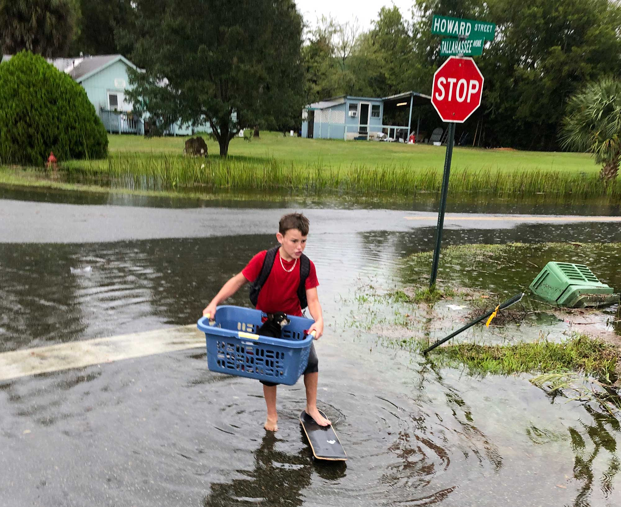 <div class='meta'><div class='origin-logo' data-origin='none'></div><span class='caption-text' data-credit='Brendan Farrington/AP Photo'>Jayden Morgan, 11, evacuates his home as water starts to flood his neighborhood in St. Marks, Fla, ahead of Hurricane Michael.</span></div>