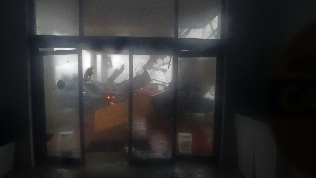 <div class='meta'><div class='origin-logo' data-origin='AP'></div><span class='caption-text' data-credit='AP Photo/Gerald Herbert'>A hotel canopy collapses onto vehicles during Hurricane Michael in Panama City Beach, Fla., Wednesday, Oct. 10, 2018.</span></div>
